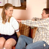 MILF Terry Nova has her giant fun bags liberated by boy pal from bra in a mini-skirt and knee socks