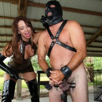 Dominant Brianna and several other brutish dolls manhandle masculine slaves before caging them