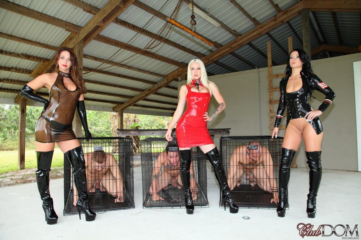 Domina Brianna and several other depraved girls manhandle male subs before caging them