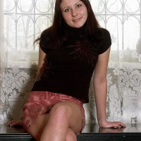 Naked amateur dark haired solo chick showing off unshaven gash in bare feet on bench