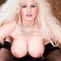 Natural light-haired Jay Killer demonstrates her huge titties in a black g-string and hosiery