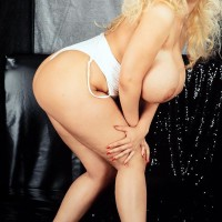 All natural golden-haired Julia Miles twerks her humungous bootie before touting her large hooters