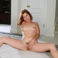 All-natural ginger-haired captures her killer butt before showing her shaved beaver while alone