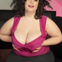 Overweight dark-haired solo model Mia Beauty disrobing down to her bra and panties