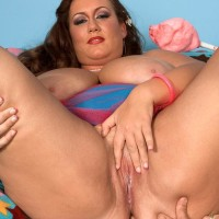 Plus size female Rose Valentina masturbating while tonguing cotton candy