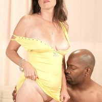 Old dame Gillian Sloan shows her bald honeypot on the lap of young black dude