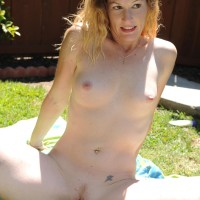 Aged first timer doll peels off bathing suit to pose naked outdoors in back yard