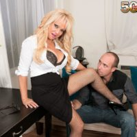 Elder light-haired chief lady Bella Dea uncovering giant hooters before providing oral pleasure in office