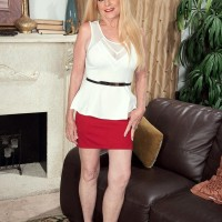 Mature ash-blonde doll Charlie has her hefty tits unsheathed by junior boy in a crimson micro-skirt