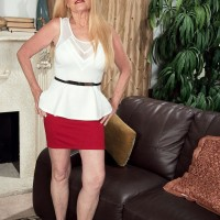 Mature sandy-haired doll Charlie has her humungous tits revealed by junior dude in a crimson micro-skirt