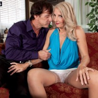 Mature platinum-blonde dame Chery Leigh uncovers her breasts in tan nylons for her husband