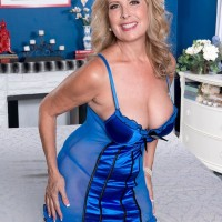 Elderly golden-haired broad Laura Layne whipping out humungous ass in stockings and pumps for junior dude