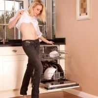 Senior fair-haired broad ditching denim jeans in kitchen to toy hairy snatch in barefeet