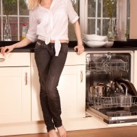 Older light-haired gal getting rid of denim jeans in kitchen to toy fur covered snatch in barefeet