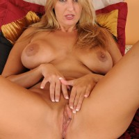 Old yellow-haired MILF reveals her massive juggs previous to slipping off her thong and masturbating