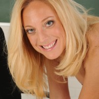 Elder yellow-haired MILF taking off biz clothes and lingerie to model naked