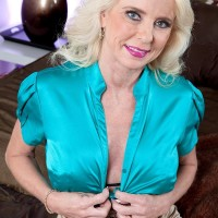 elder ash-blonde broad Cammille Austin tempts her paramour in a taut mini-skirt in the bedroom
