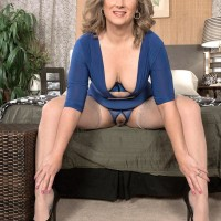 Older blonde broad Catrina Costa teases her roped up paramour in stockings and high heeled shoes