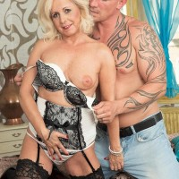 Experienced blonde dame Coco de Marq is liberated from a crimson dress before sex with her junior lover