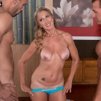 Elderly fair-haired yoga tutor Jenna Covelli fellating student's large sausages in class