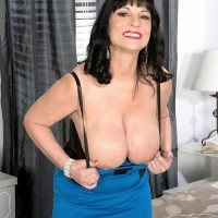 Aged brunette lady Elektra letting immense funbags free from sundress in pumps