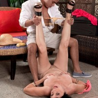 Senior brown-haired woman Raven Flight is stripped nude by her younger Latino lover