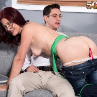 Mature dame Dana Devereaux seducing junior man for sex outfitted glasses