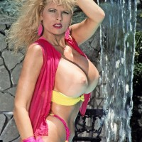 Mature adult video star Kimberly Kupps looses her massive melons from bathing suit top by the pool