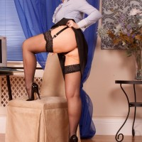 Elder red-haired amateur unveils her tush and gash in glasses with hose and garters