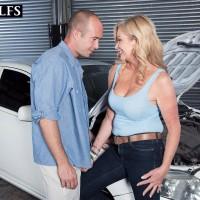 Over 50 light-haired Lauren Taylor has her big boobies and butt revealed by while in a garage