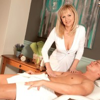 Over Fifty blond MILF Arjana seducing junior dude in milky hosiery and garters