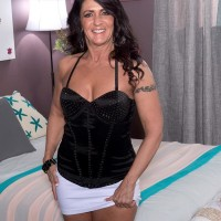 Over Fifty black-haired Azure Dee seducing junior guy in mini mini-skirt and high heeled shoes
