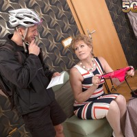 Over Fifty cougar Georgina giving pedal bike courier blowjob in white hose and high-heels