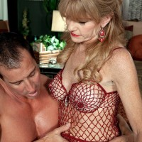 Over 50 MILF Denise Day letting immense boobs loose from lingerie for nip eating