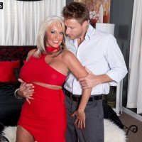 Over Fifty MILF Sally D'Angelo having enormous tits freed from dress by junior stud