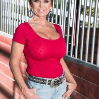 Over 60 dame Gina Milanos seduces a youthful man with her large melons in denim shorts