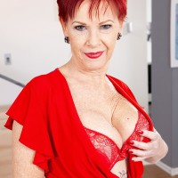 Over Sixty red-haired Caroline Hamsel plays with her boobs adorned crotchless underwear