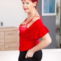 Over Sixty ginger-haired Caroline Hamsel plays with her boobies wearing crotchless panties