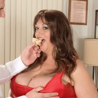 Plus-size hotty Jennifer takes a cum-shot on her immense boobies while eating food