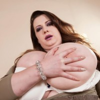 Plus size ginger-haired Anna Beck bares her giants tits from a sundress afore a mirror