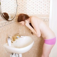 Panty garbed inked amateur black-haired exposing small teen breasts in bathroom