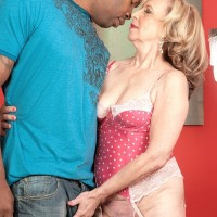 Small granny Miranda Torri has her erect nips sucked by her younger black lover