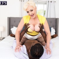Platinum yellow-haired granny Seka Ebony sucks off a younger man's large black penis