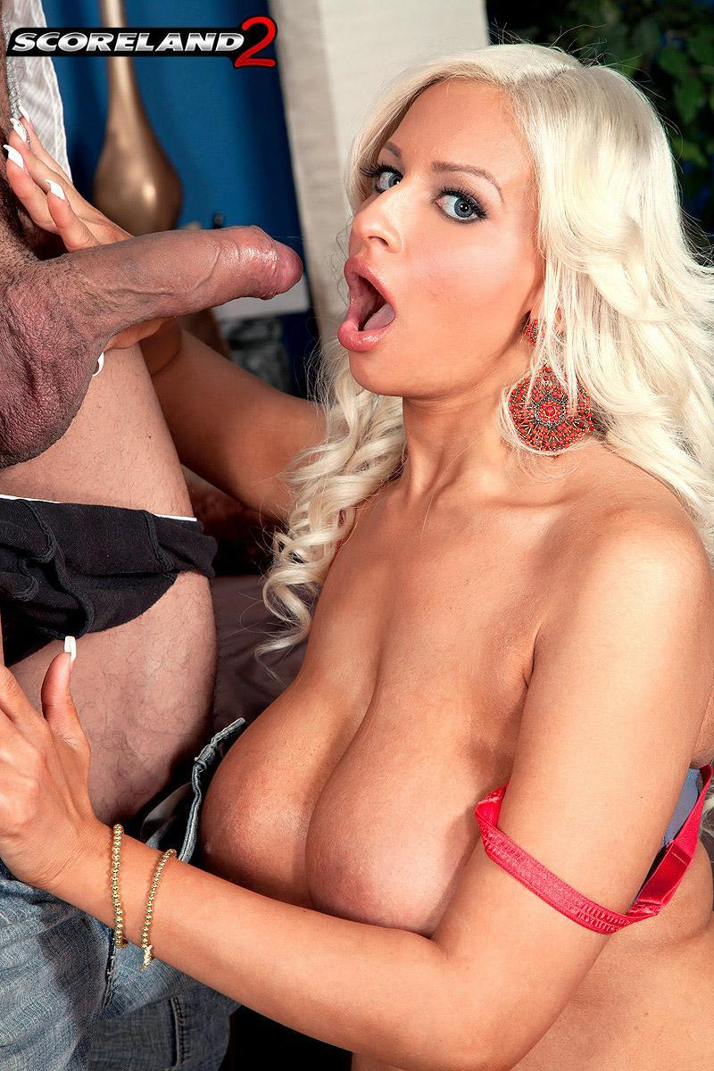 Platinum ash-blonde MILF Holly Brooks entices a man with her gigantic hooters in a miniskirt