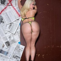 Platinum golden-haired MILF Layla Price tugging suction fuck-sticks at gloryhole in bikini and high-heels