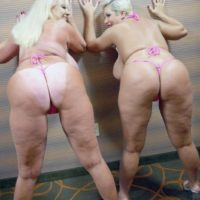 Pornographic starlets Kayla Kleevage and Claudia Marie share a lezzy kiss after modelling bathing suits