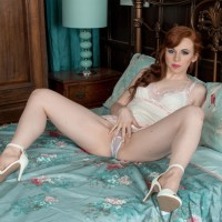 Red-haired babe Vivi St. Claire baring hairy ginger cooch from enticing lingerie