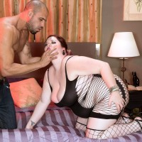 ginger-haired BIG BEAUTIFUL WOMAN Trinety Guess dirty dances her ass in a revealing dress while seducing a stud