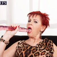 Ginger-haired granny Caroline Hamsel gobbles and gargles her bevy of sex toys in panties