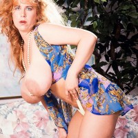 Ginger-haired MILF Tabatha Towers whips out her gigantic breasts in over the knee hose